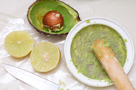 making puree food for baby made by avocado and lemon
