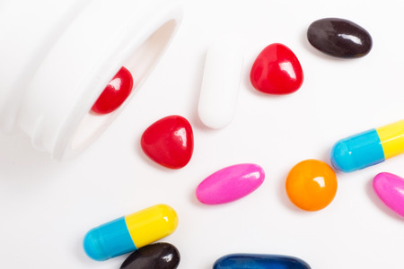 pills of vitamin and medicine on white background