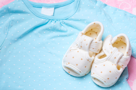 cute baby shoes for kids on blue clothes
