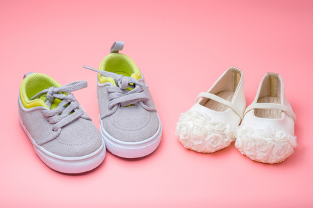 cute baby shoes for kids on pink background