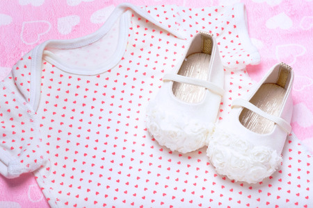 cute baby shoes for kids on sweet clothes Reklamní fotografie