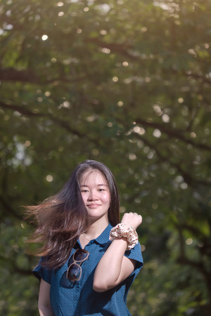beautiful Asian Girl smile and turn around to look at the camera