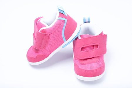 cute baby shoes for kids on white background