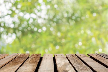 wooden floor on blurred tree background