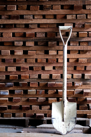 Shovel on wood timber construction material  background Reklamní fotografie