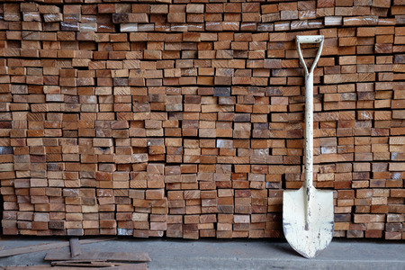 Shovel on wood timber construction material  background 写真素材