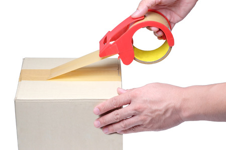 man hand packing box with tape on cardboard box 写真素材