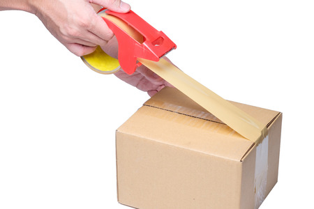 man hand packing box with tape on cardboard box Reklamní fotografie