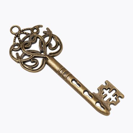 old gold skeleton key isolated on white background Stockfoto