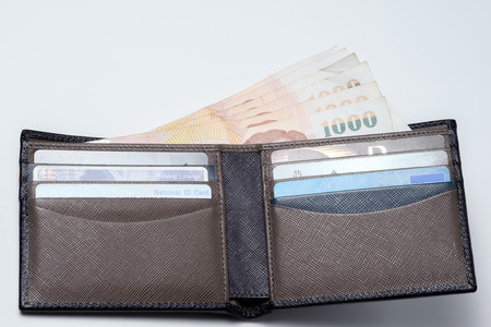 thai money and credit card in lather wallet