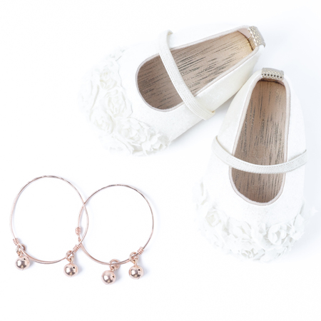 pink gold anklet and cute shoes for baby.