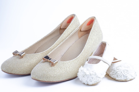 woman and baby shoes on white background.