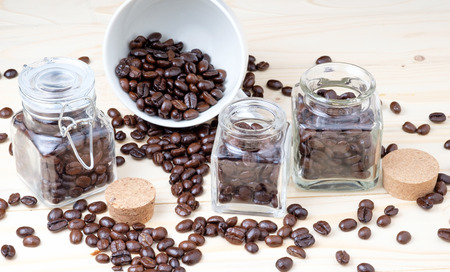 coffee beans in glass bottle. 写真素材