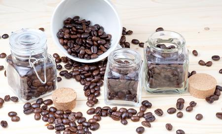 coffee beans in glass bottle. Reklamní fotografie
