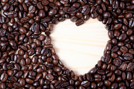 heart symbol made by coffee beans