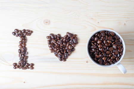word I LOVE Coffee made by coffee beans and cup of beans Reklamní fotografie - 45504443