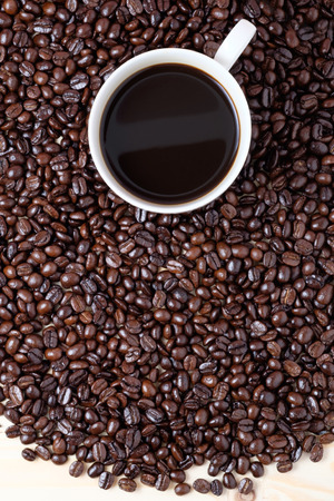 cup of coffee on coffee beans 写真素材