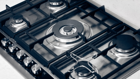 Metallic gas range with knobs and rings  Stock fotó