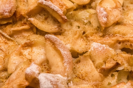 An apple pie with clearly visible parts of apples sprinkled by powdered sugar  Stock fotó