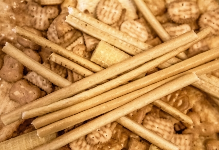 Cookies, crackers, sticks and waffles background
