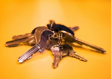 ability: Bunch of glaring metallic keys on shiny  golden-yellow table
