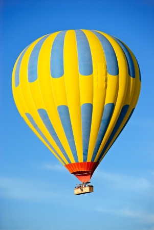 Hot air balloon tour against a blue sky photo