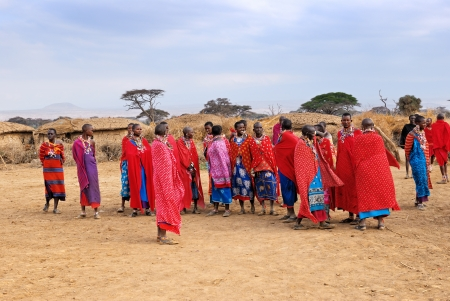 MASAI MARA, KENYA, AUGUST 23: Group of unidentified African women from Masai tribe prepare to show with traditional Jump dance on August 23, 2010 in a local village near Masai Mara National park.