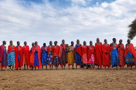MASAI MARA, KENYA, AUGUST 23: Group of unidentified African women from Masai tribe prepare for traditional Jump dance on August 23, 2010 in a local village near Masai Mara National park.