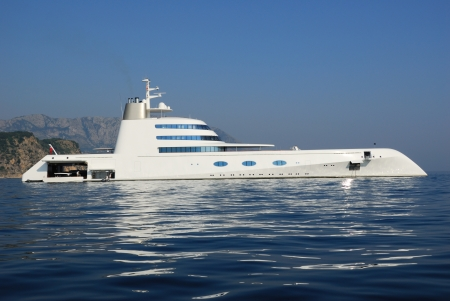 mega: MONTENEGRO  AUGUST 2: Luxury yacht A on August 2, 2010 in gulf of Budva. It is 118 meters long, has a 3 swimming pools aboard, an owner?s suite, 6 guest suites and accommodations for 42 staff, which includes 5 guest?s staff. The owner is A.Melnichenko, a  Editorial