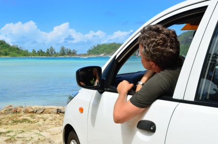 A place of a destination   Man in the car look on the sea photo