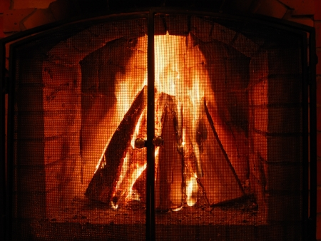 Fireplace with burning logs photo