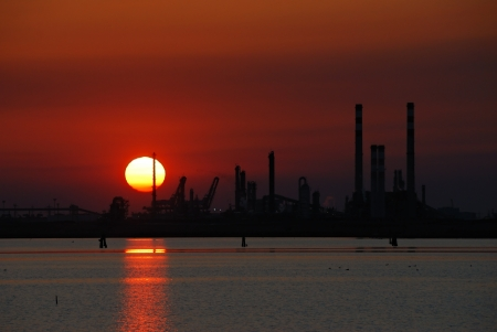 Silhouette of factory in the evening photo