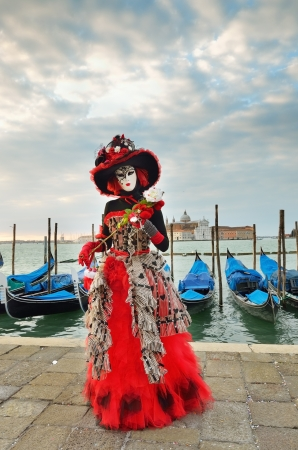 VENICE - MARCH 7: An unidentified masked person in costume in St. Mark Stock Photo - 13887132