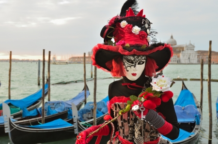 VENICE - MARCH 7: An unidentified masked person in costume in St. Mark Stock Photo - 13887121