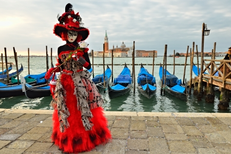 VENICE - MARCH 7: An unidentified masked person in costume in St. Mark