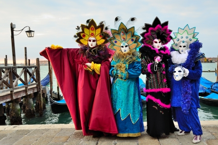 venice carnival: VENICE - MARCH 7: Three unidentified masked persons in costume in St. Mark