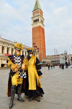 VENICE - MARCH 7: Two unidentified masked persons in costume in St. Mark Stock Photo - 13887360