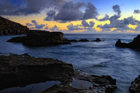 golfo: Atlantic sunset over Canary  Island, Lanzarote, El Golfo bay