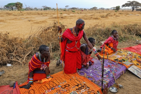 traditional goods: MASAI MARA, KENYA - AUG 24: Local sellers from Masai tribe offer goods in the market, on Aug 24, 2010 in Masai Mara. Traditional handmade accessories very popular souvenir from Kenya for most tourists