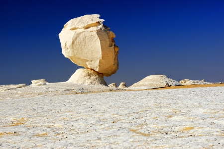 Unusual limestone formation in the White desert, Sahara, Egypt  Rock like man photo