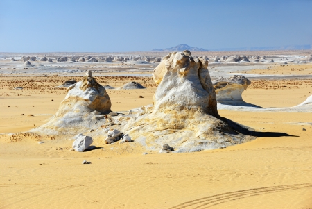 Typical landscape in the White desert, Sahara, Egypt  Sand and unusual limestone formation photo