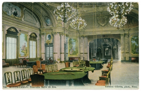 monte: FRANCE - CIRCA 1902: Vintage postcard with weathered edges on white background printed in circa  1902, France. Retro image of the Casino game Hall, Monte-Carlo