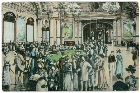 FRANCE - CIRCA 1902: Vintage postcard with weathered edges on white background printed in circa  1902, France. Retro image of Casino game Hall, Monte-Carlo, depicts a crowd of gamblers in vintage fashion dress