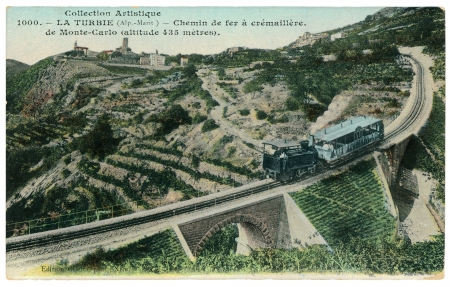 FRANCE - CIRCA 1902: Vintage postcard with weathered edges on white background printed in circa 1902, France. Retro image of an old rack railway and a puffer with the carriage in La Turbie region,  Monte-Carlo