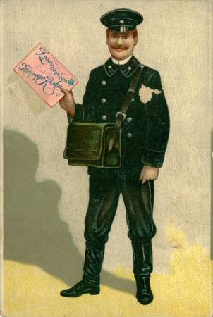 RUSSIA - CIRCA 1908: Vintage Christmas post card with weathered edges printed in 1908, Warsaw. Smiling postman dressed in uniform holds in his hand a big envelope greeting, circa 1908