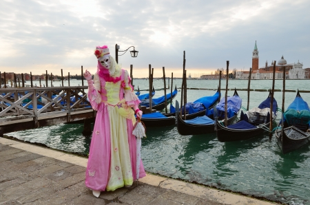 VENICE - MARCH 7: An unidentified masked person in costume in St. Mark Stock Photo - 14041521