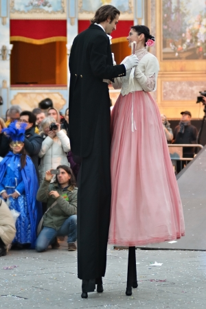 VENICE - MARCH 7: Couple An unidentified person dancing on stilts in costume in St. Marks Square during the Carnival of Venice on March 7, 2011. The 2011 carnival was held from February 26th to March 8th.