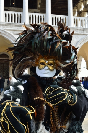 VENICE - MARCH 7: An unidentified masked person in costume in St. Mark's Square during the Carnival of Venice on March 7, 2011. The 2011 carnival was held from February 26th to March 8th. Stock Photo - 14041529