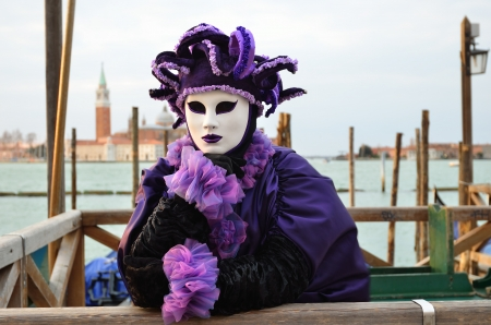 VENICE - MARCH 7: An unidentified masked person in costume in St. Mark's Square during the Carnival of Venice on March 7, 2011. The 2011 carnival was held from February 26th to March 8th. Stock Photo - 14041509