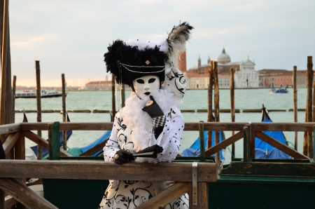 VENICE - MARCH 7: An unidentified masked person in costume in St. Mark's Square during the Carnival of Venice on March 7, 2011. The 2011 carnival was held from February 26th to March 8th Stock Photo - 14041510
